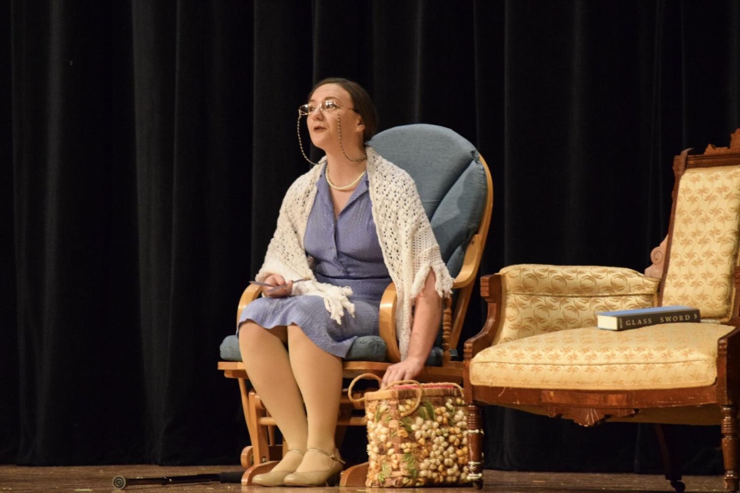 Senior Megan Osborne prepares to complete a world record in the one act play entitled