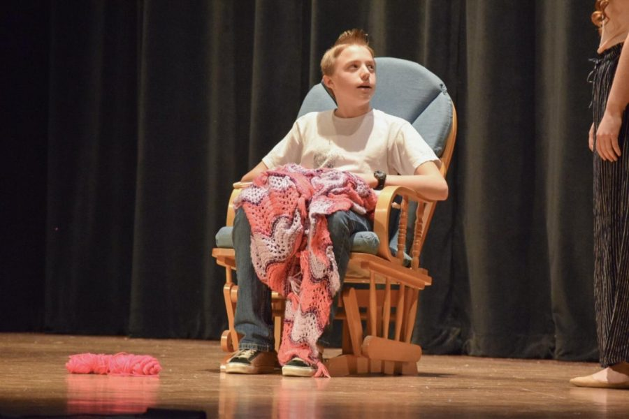 Freshman Hayden Brite knits anxiously while talking to his character's mother.
