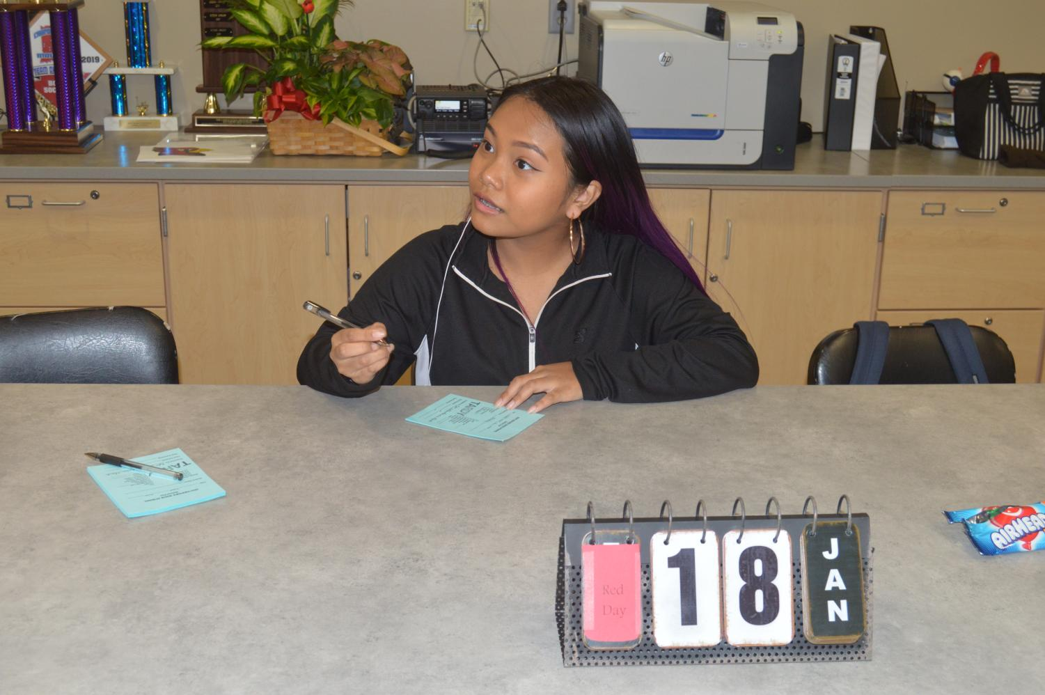 Freshman Dawt Len Sung Thannget, a student assistant for the main office, writes a pass during second period on Jan. 18.