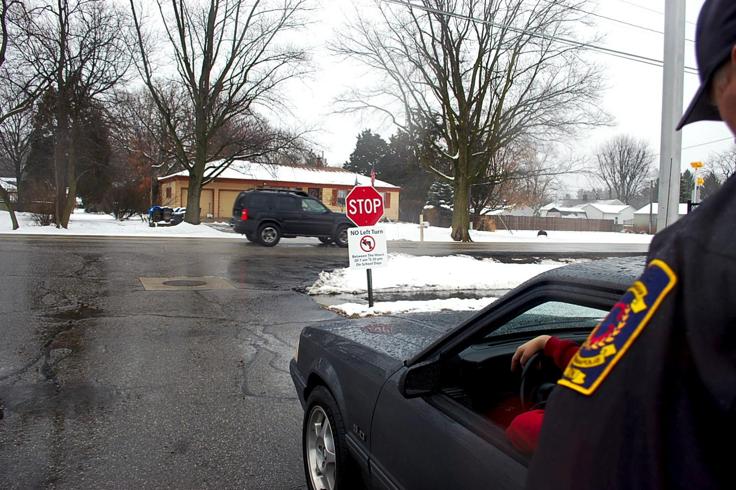 Junior Wha Hek being stopped after turning left out of the student parking lot on Jan. 14. Signs were recently installed instructing students to not turn left out of the lot for safety reasons.