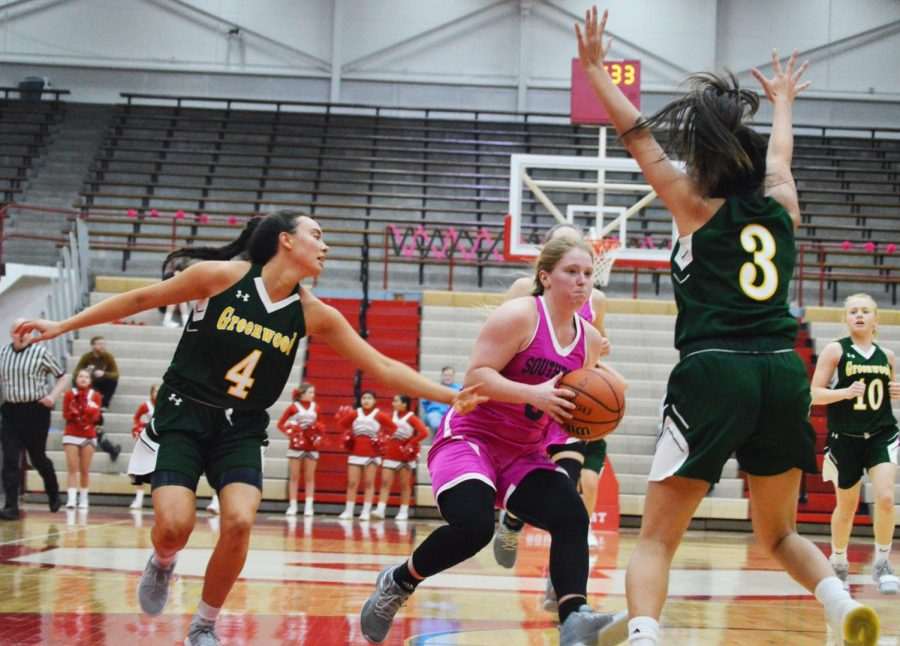 Senior Ashley Raisor takes the ball into the paint against two Greenwood defenders on Jan. 15.