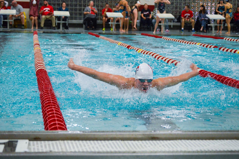 Sophomore Blake Kottlowski swims the butterfly stoke during the meet against PMHS on Jan. 10.