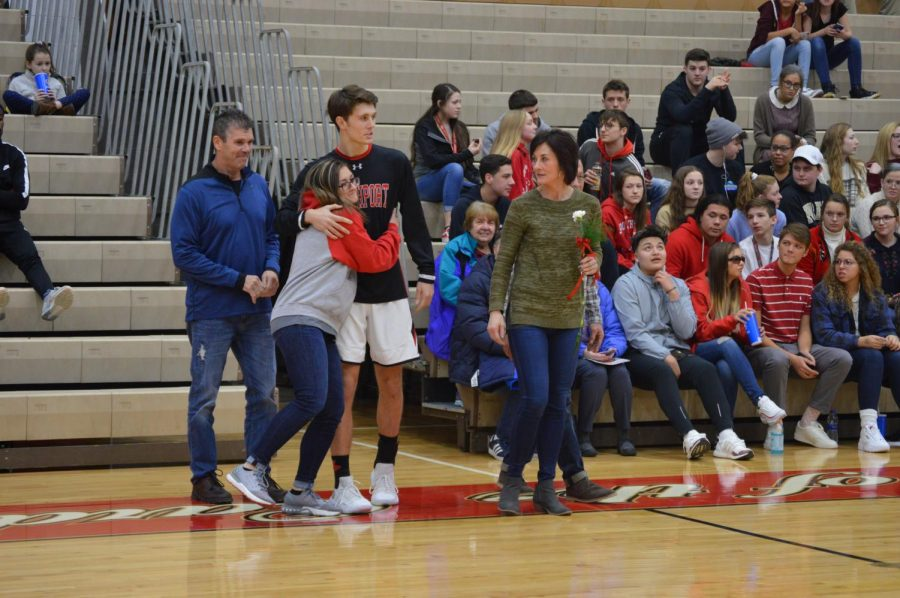 Senior+Chaz+Hinds+hugs+his+sister+as+he%27s+honored+during+senior+night+on+Feb.+15.+He+and+six+other+players+were+honored.+