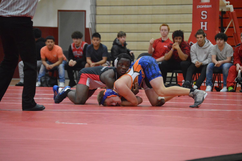 Sophomore Simon Mpole wrestles an opponent from Whiteland High School on Dec. 6.
