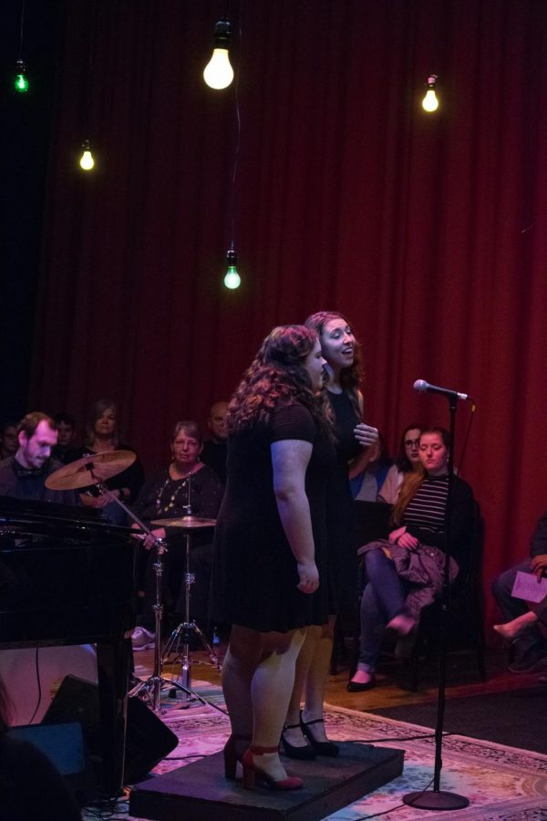 Seniors Katie Arnold and Aubrey Popovic sing a jazz duet.