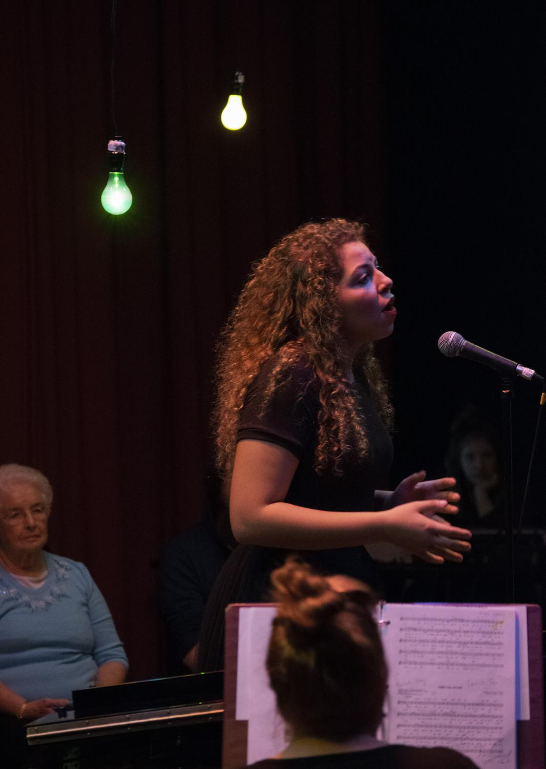 Senior Camille Khelseau performs the first jazz solo of the night at the Premium Blend cabaret concert on Thursday, Feb. 21.