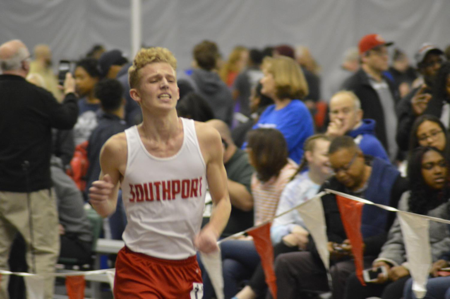 Junior Justin Polly finishes his second to last lap of the 3200-meter run at the Lawrence Central Invite on March 8.