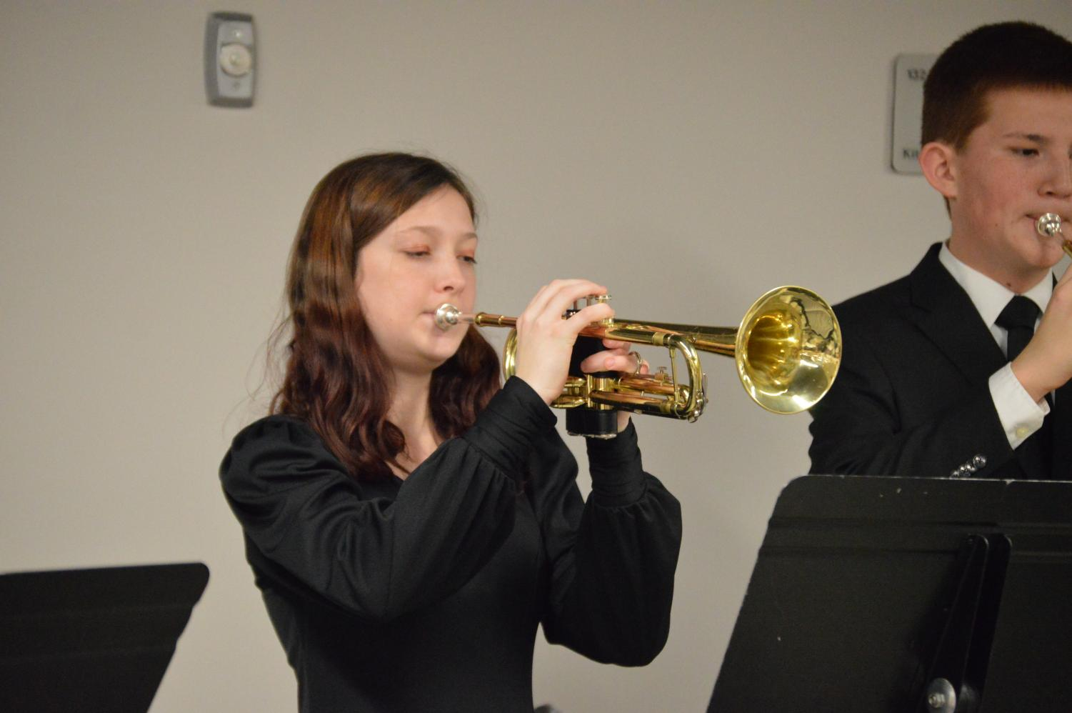 Freshman+Madison+Neuman+plays+her+trumpet+during+warm+ups+to+get+ready+for+the+concert.