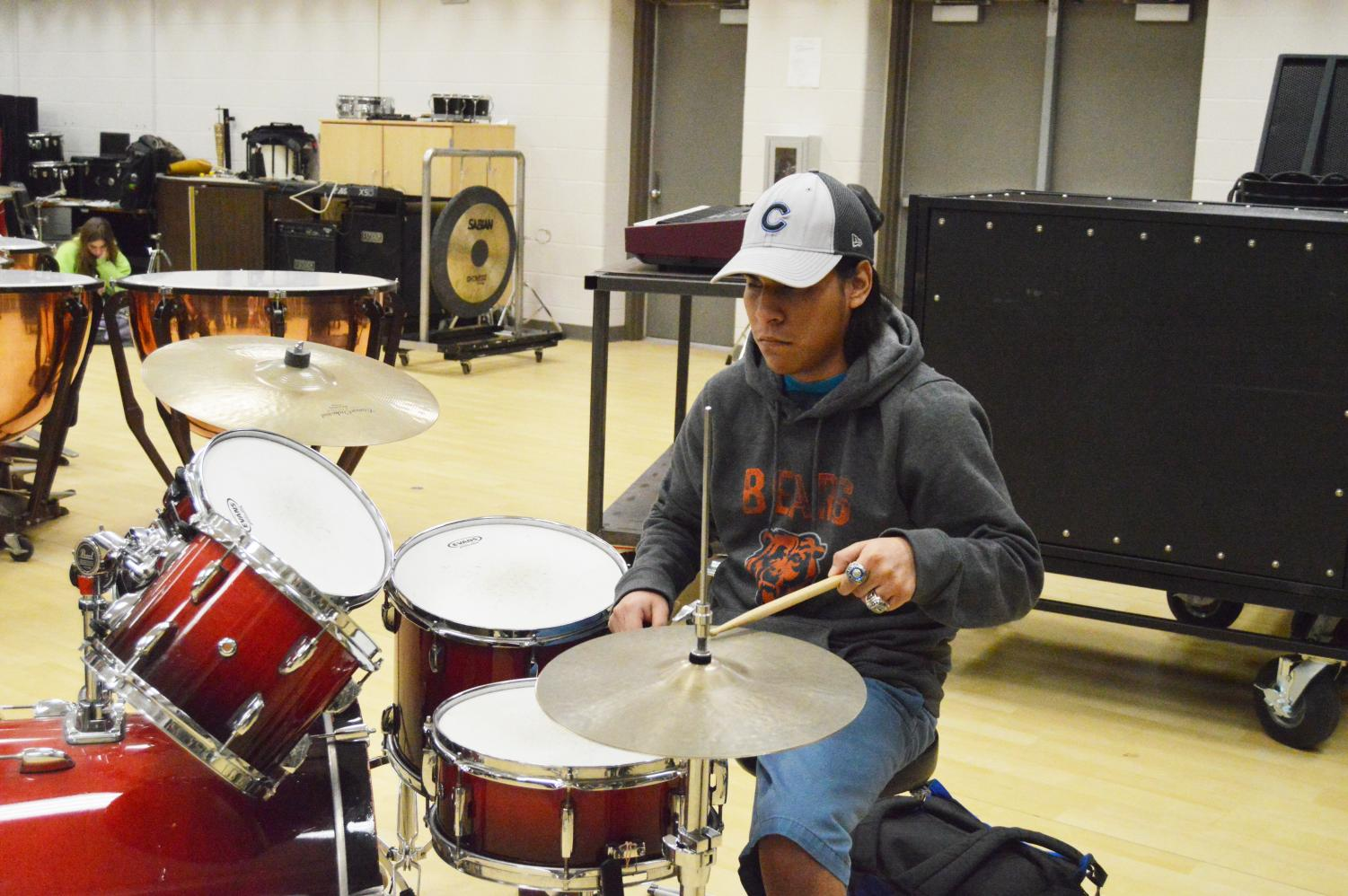 Tello plays the drums during advanced band class. He has had a love for drumming since eighth grade.