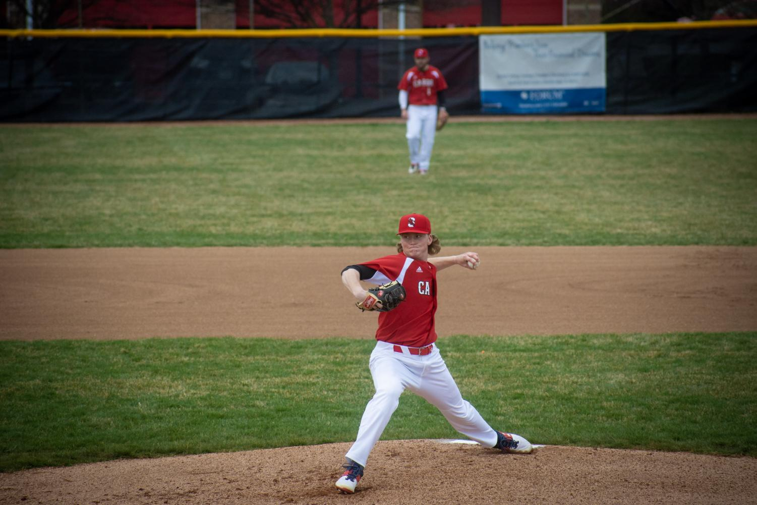 Senior Avery Short pitches against Terre Haute South on April 5.