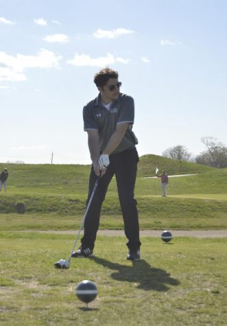 Senior Zach Bozarth sets up to hit the ball at a practice on April 15.