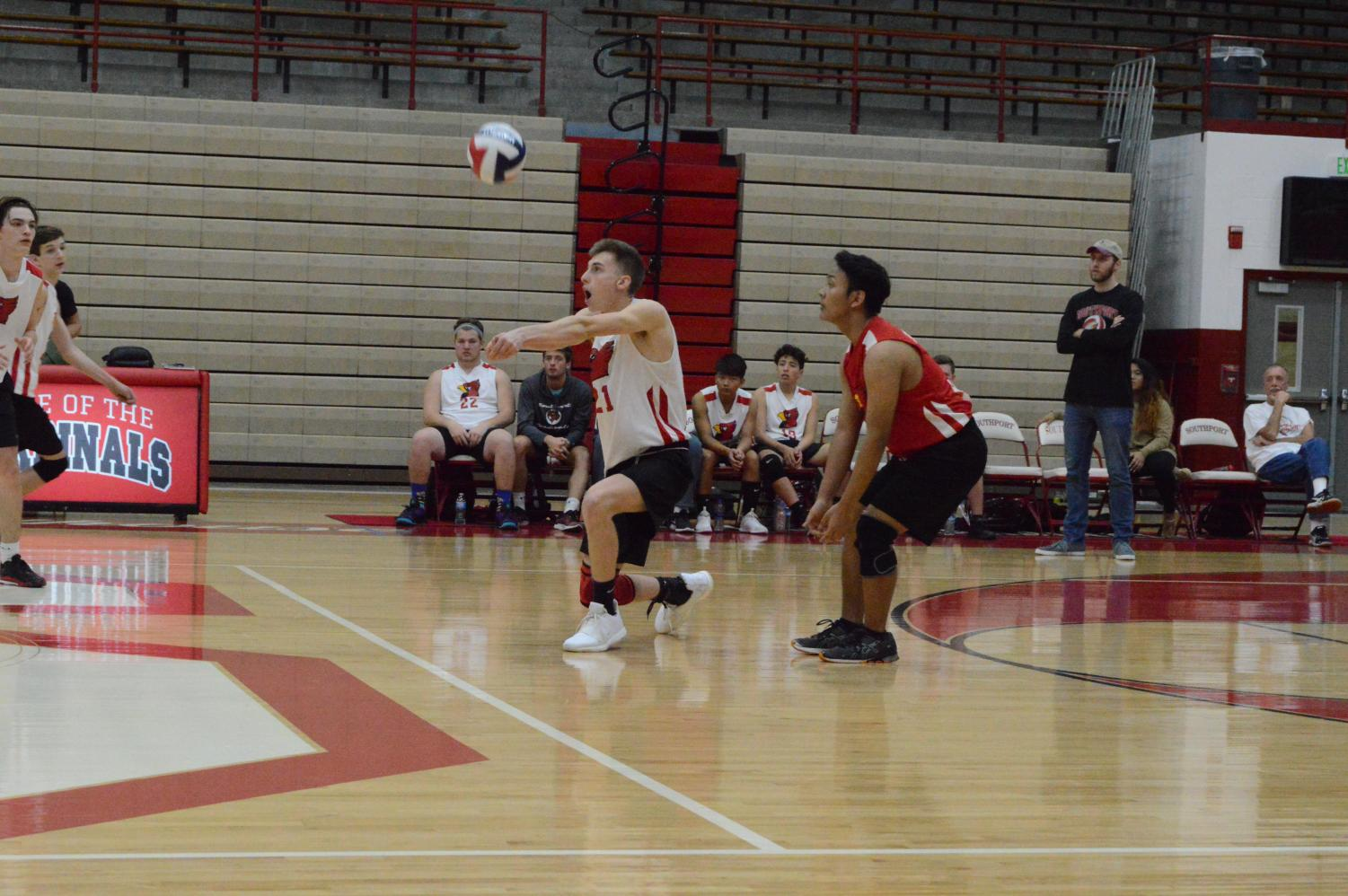 Junior Carson Meadors gets ready to return the ball to the opposing team during their game against LHS on April 11.