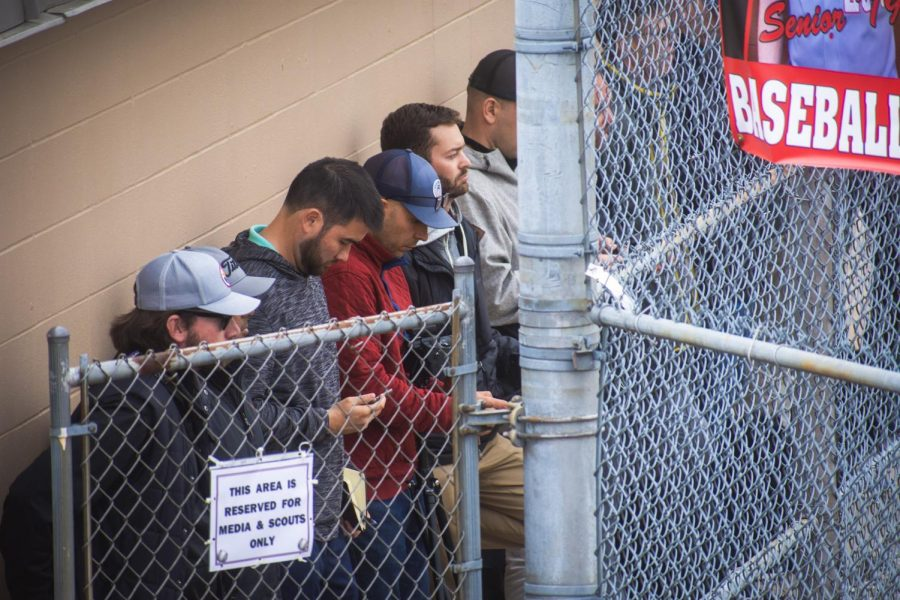 MLB scouts watch was senior Avery Short pitches against Terre Haute South on April 5.
