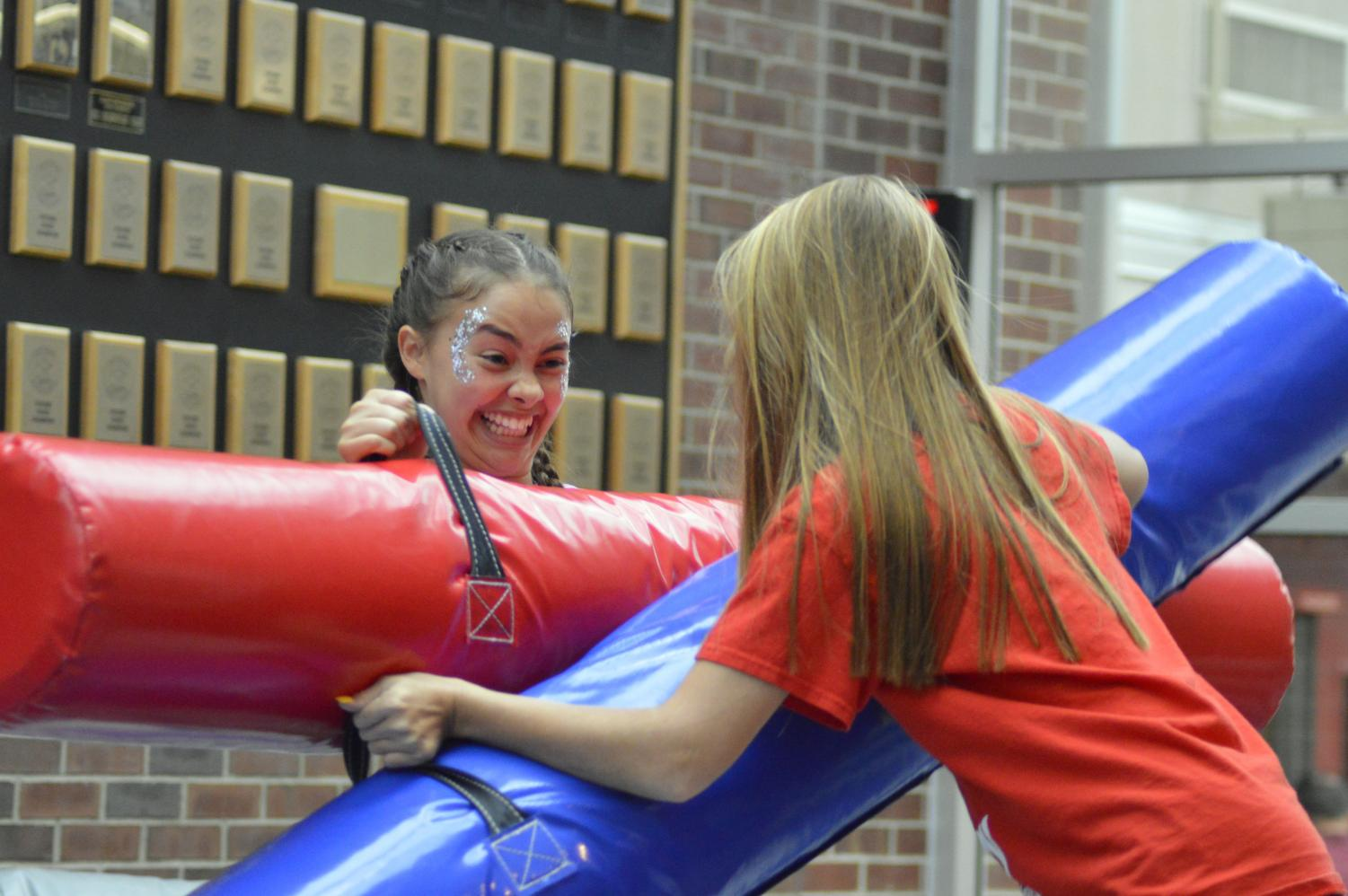 Sophomore Mariah Murillo jousts with sophomore Natalie Davis in the bounce jousting arena.