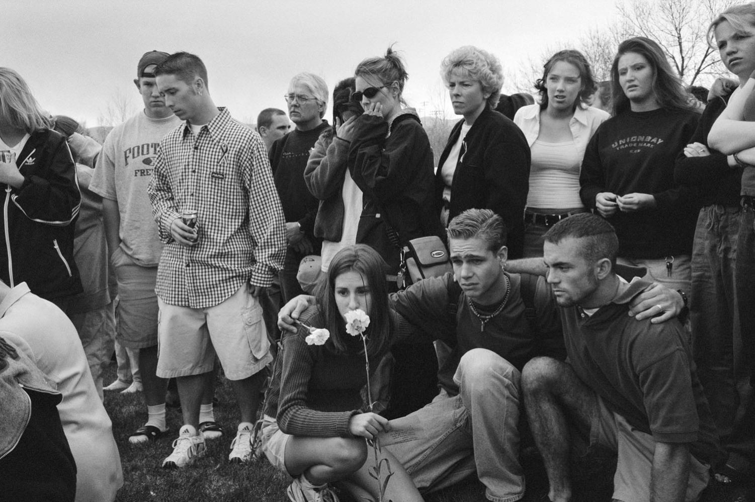 The day after the Columbine High School massacre, students gathered outside the school to remember their classmates.
