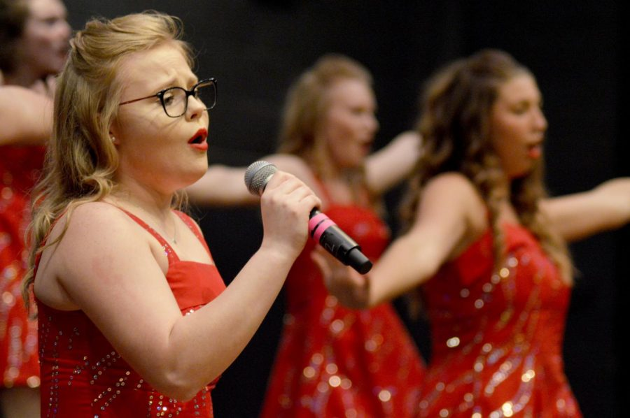 Senior Brittany Bryant sings and dances at her final choir performance of high school. Bryant has been a part of Choir for three years.