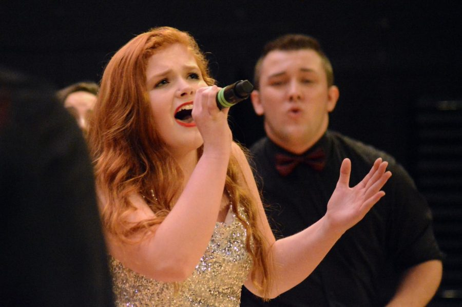 Senior Cassie Napier sings at her last performance of high school.