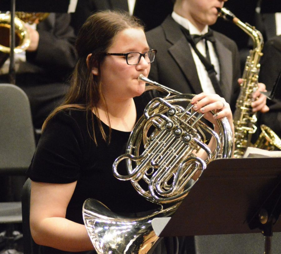 Junior Sarah Rusaw plays her french horn. Rusaw has been playing for five years and is one of only two french horns.