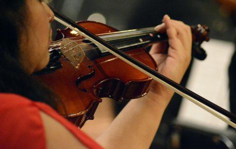 Senior Esmeralda Tello-Tello plays the violin at Extravaganza on Fri, May 17.