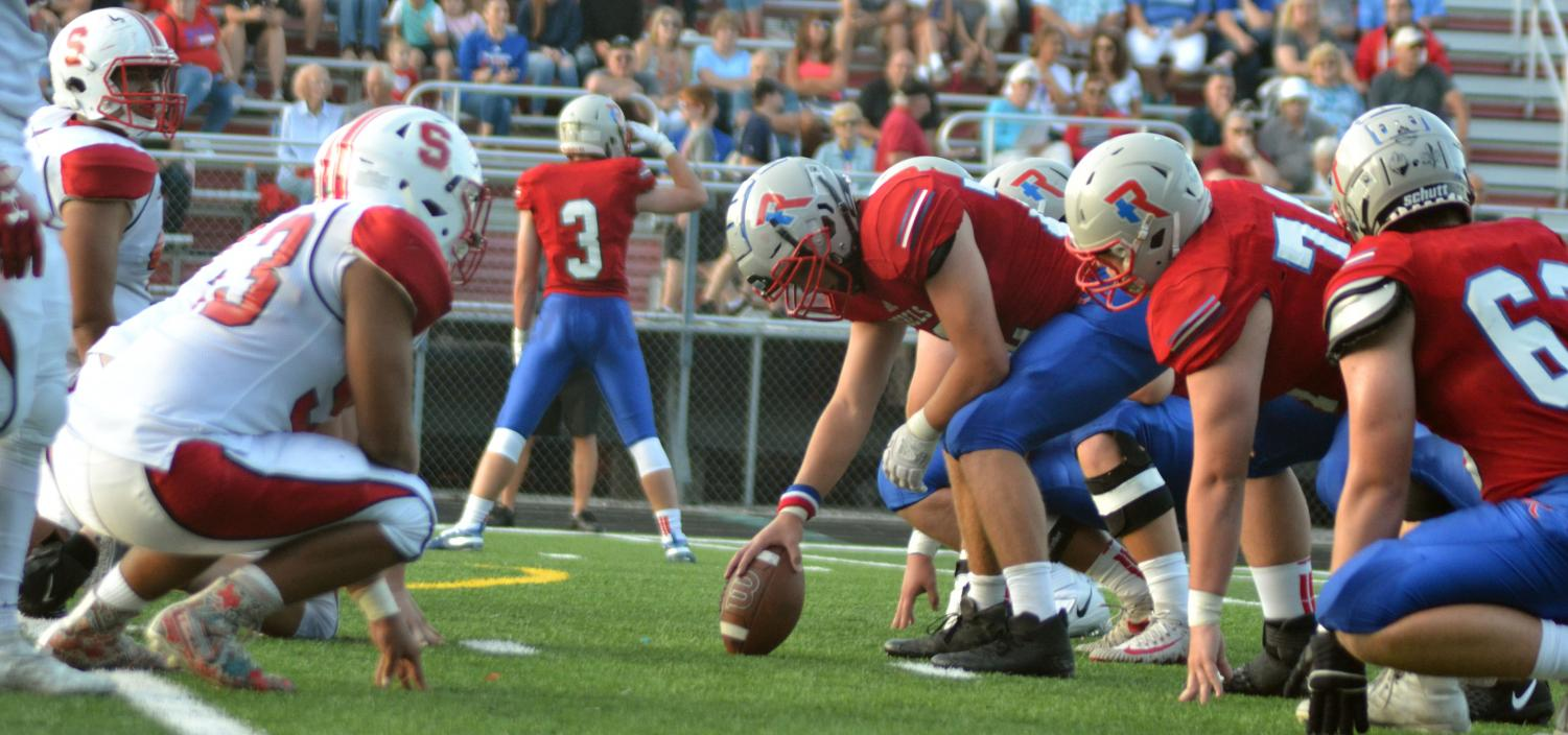 Junior AJ Helton lines up with the rest of the defensive line against the Rebels' offensive line. Helton was able to push back the Rebels a few yards. Photo by David Masengale
