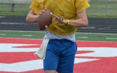 Senior Ryan Lezon prepares to throw a ball at practice. With two years of varsity football under his belt, Lezon will switch thins up by taking on a new position for the 2019 season.
