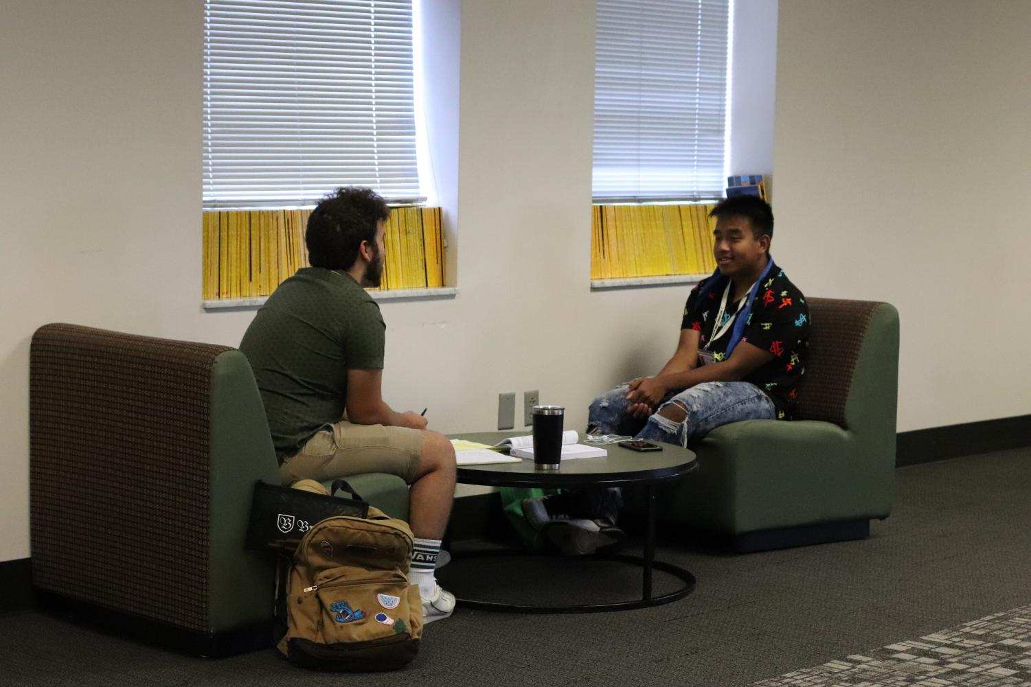 Seniors Giovani Buchanan and Cung Cem hang out and finish homework in the senior lounge. The senior lounge was introduced this school year.