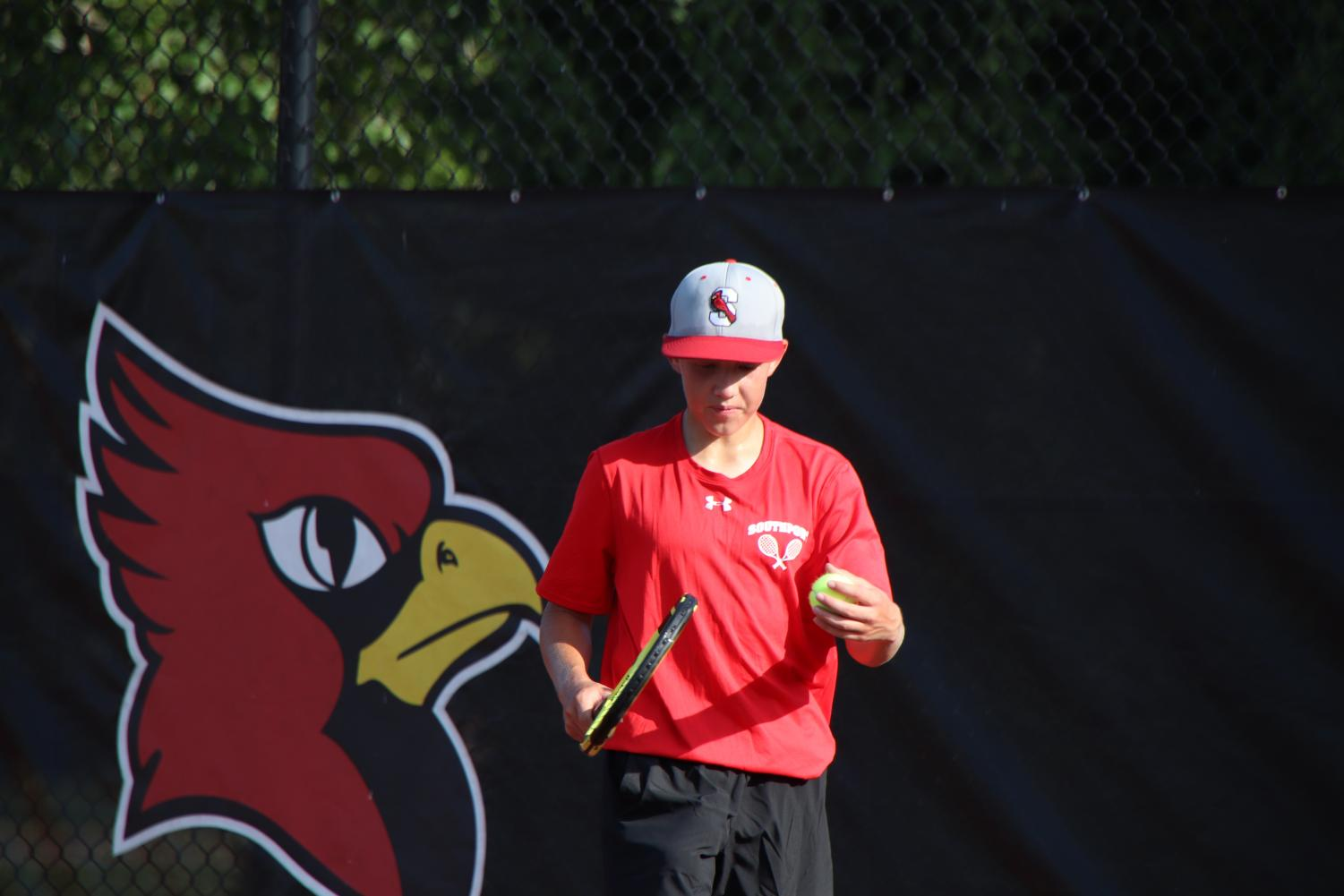 Sophomore+Micah+Fishel+gets+ready+to+serve+the+ball+during+his+tennis+match+on+Aug.+19.+Fishel+was+the+only+one+to+when+his+match.+The+final+score+against+Decatur+was+1-4.%0A