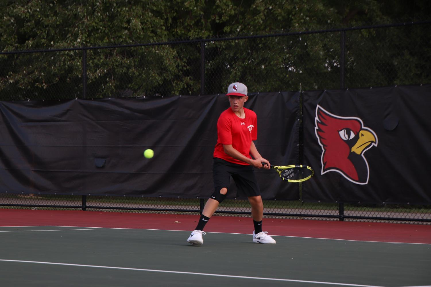 Sophomore+Micah+Fishel+watches+the+ball+come+in+to+hit+it+to+his+opponent.+Fishel+started+his+first+set+0-3+Decatur+and+came+back+to+win+the+sets+6-4+and+6-4.+