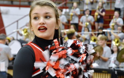 Senior Olivia Scaggs cheers at the pep rally. This year the cheerleaders performed a new dance routine, choreographed by former student Olivia Brite.