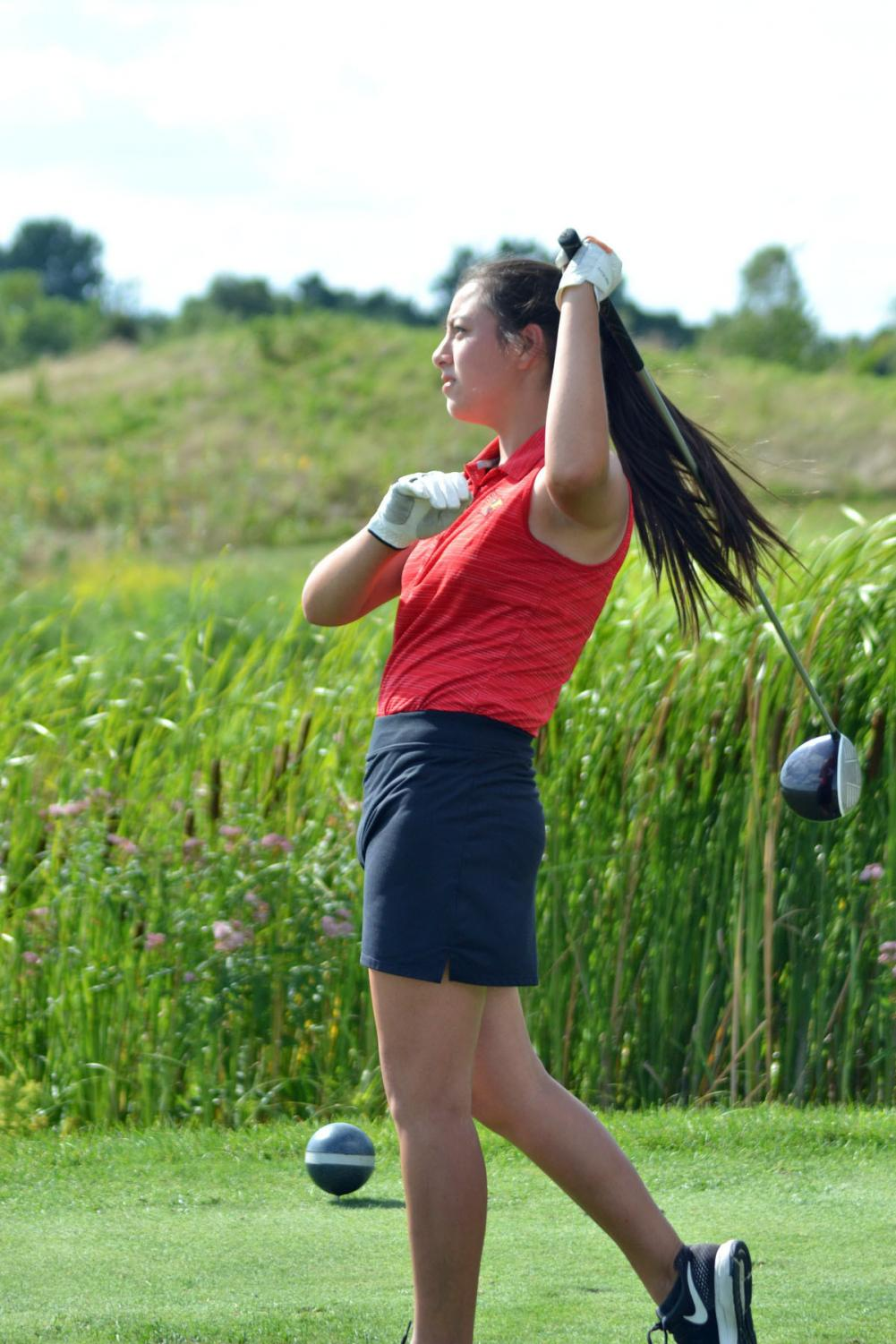 Sophomore+Sophie+Chan+kicks+off+hole+three+for+the+second+round+of+golfers.+Chan+was+followed+up+by+one+of+the+golfers+from+Ben+Davis.+Chan+had+a+career+nine-hole+low+of+43.