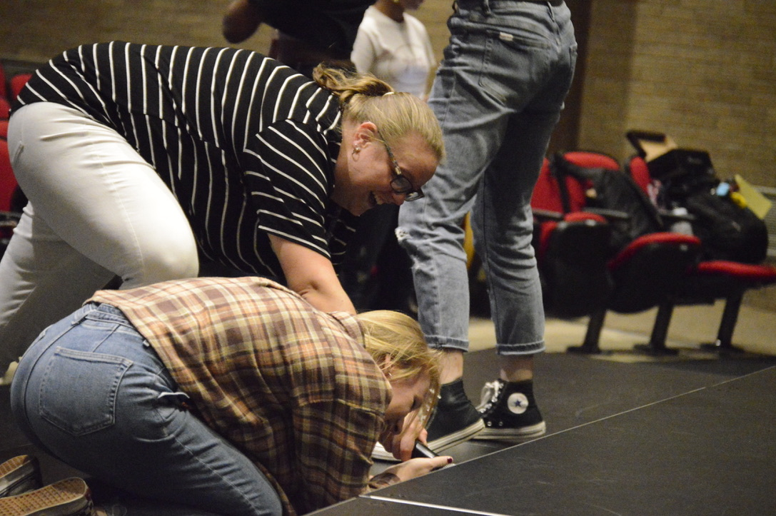 Richardson helps senior Marsela Riddle. Richardson helps with students during show choir practice.