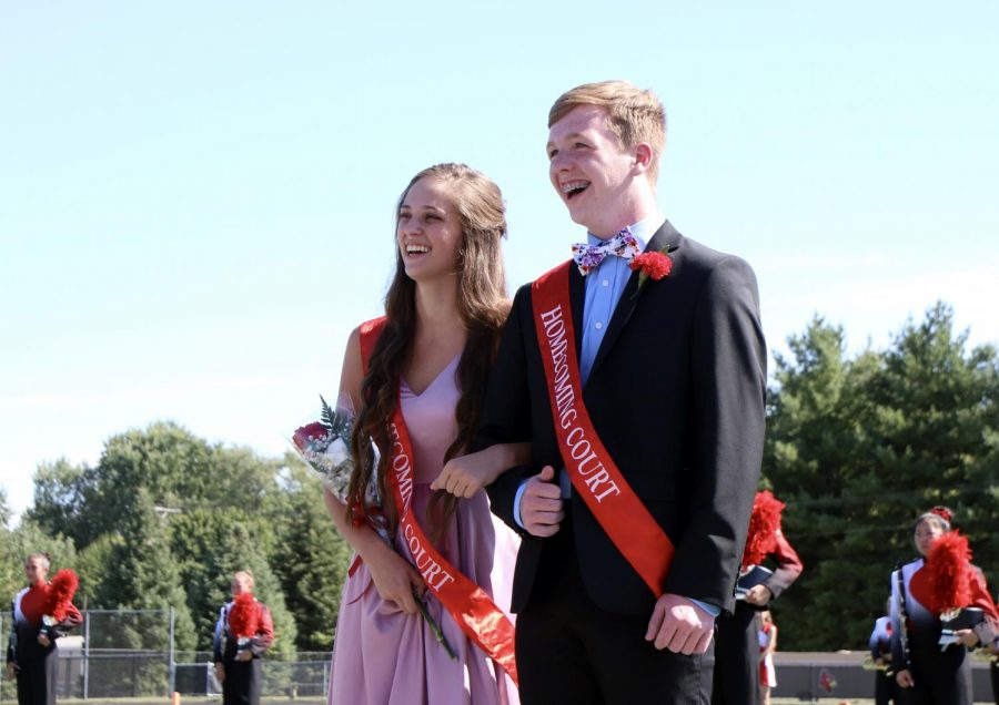Sophomores Hope Reynolds and Eli Beck laugh at their friends in the student section during half time. Reynolds and Beck represented the sophomore class homecoming prince and princess.