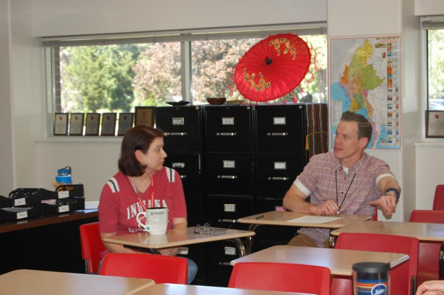 Social studies teacher David Luers and EL teacher Amy Peddie talk during a meeting of the anti-racism teachers group on Sept. 26 in Peddie's room. They are the leaders of the group.