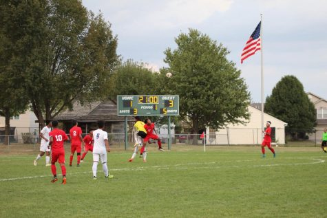 Senior Christian Thang is called for a foul in the box while going up for the ball. This foul gave the Falcons a penalty kick and allowed them to go up 4-1.