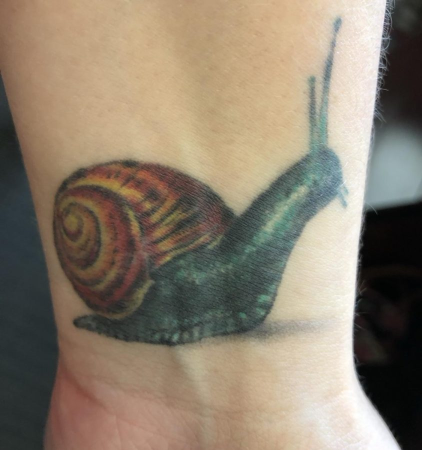 English teacher Heather Todero has a tattoo commemorating Woodward and her love for snails.