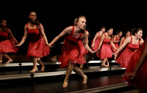 Senior Marsela Riddle dances during the show choir concert. Riddle has been singing and dancing in show choir for two years.
