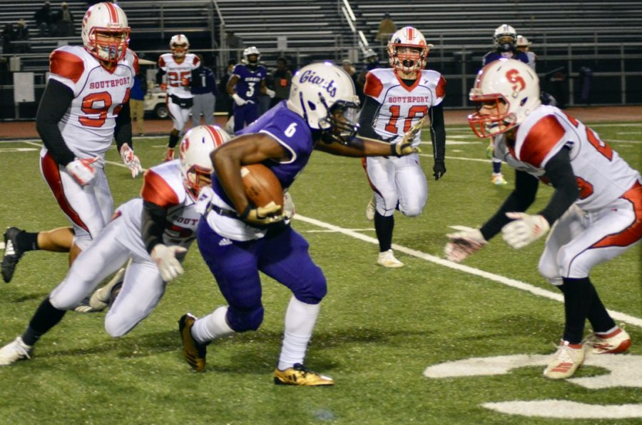 Sophomore Nolan Hall tackles Ben Davis wide receiver  with help from sophomore Mitchell Unversaw.