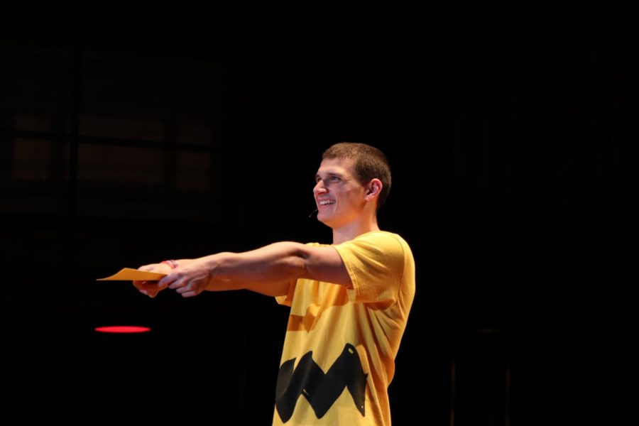 Senior Justin Tidd acts out a scene in the first act, in which he talks about giving a letter to character Lucy van Pelt. Tidd is the lead part, Charlie Brown, in this weekend's musical.