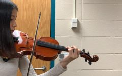 Mariko practices consistently to work on her skills. Her mom first got her a tutor and she practiced on a box violin.