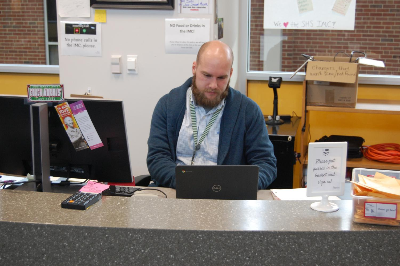 Media Clerk Matt Norris fixes a Chromebook on Nov. 20. Norris began working at SHS at the beginning of the school year.