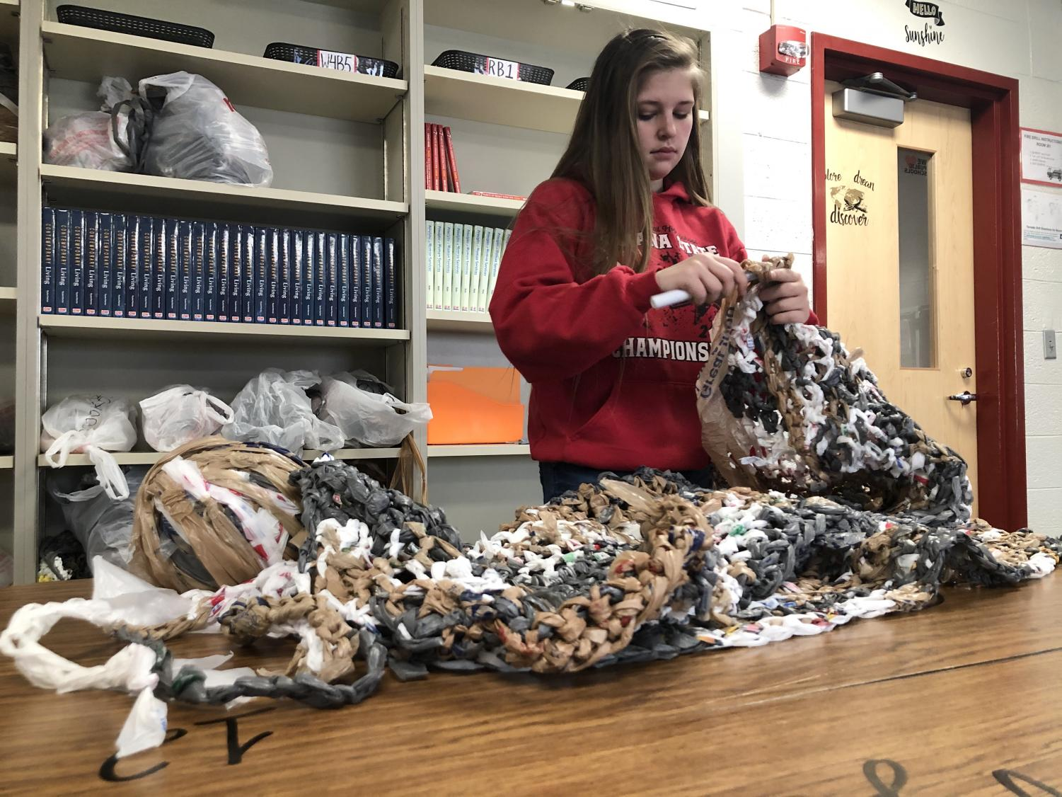 Senior Makayla Maxwell works on a mat. This is the Human and Social Services students' end-of-the-semester project.