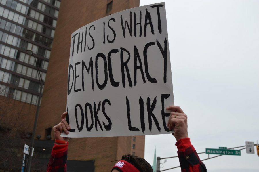 A sign held during the march at the Red for Ed rally. There were almost 15,000 people in attendance, and thousands of signs were held.