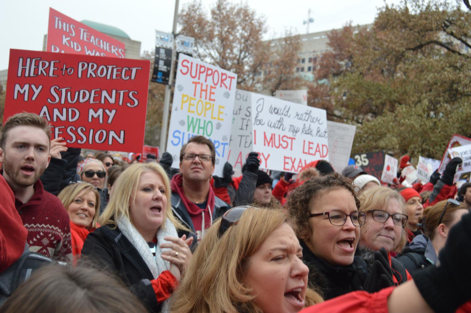 SHS teachers, along with educators from across the state, march around the Statehouse. The march was the second half of the rally, following live music and speeches.