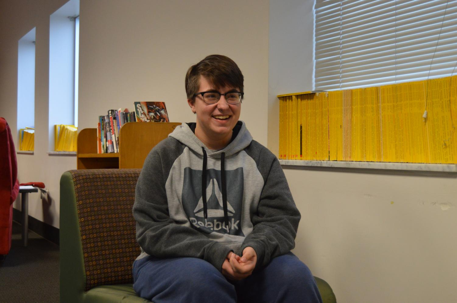 Junior Thomas McNeil talks with his friends during school on Dec. 18. McNeil came out as transgender in 2018 and is thankful for the friends that have stayed by his side.