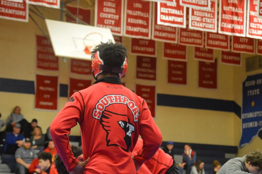 ON THUR. JAN. 16 THE WRESTLING TEAM COMPETED AGAINST THE RONCALLI REBELS, LOSING 52-24.