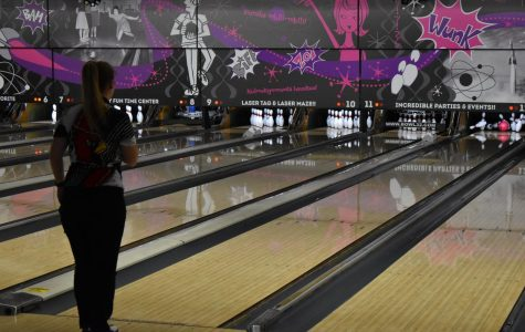 Madison Woodmansee watches as she bowls a strike. She had five strikes in her second game.