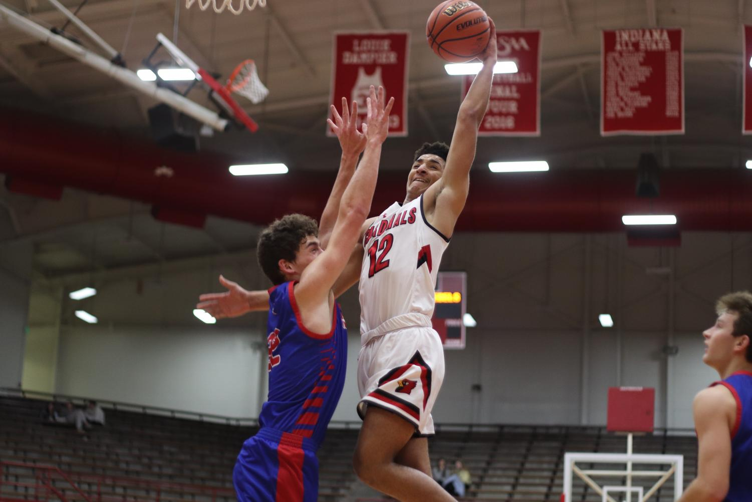 Attempting a layup, senior Brevin Jefferson scored the most points during the game. Jefferson scored a total of 20 points.