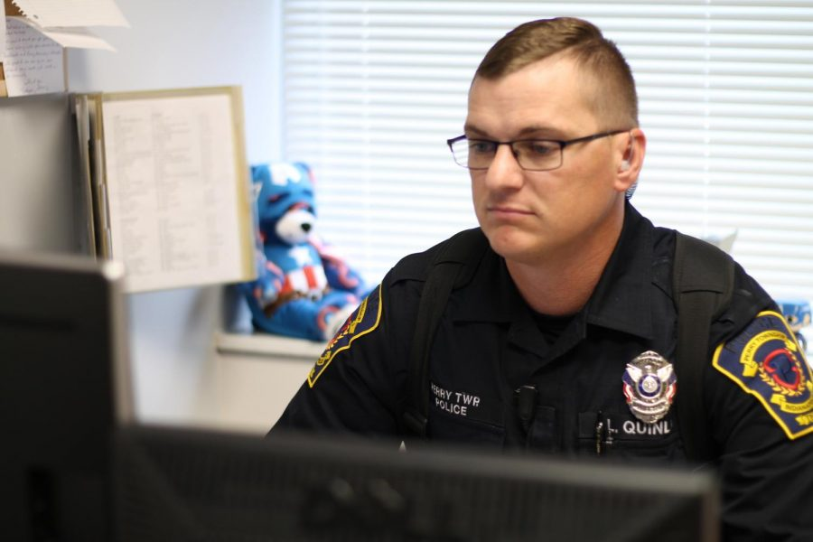 Officer Luke Quinlan works in his office during second lunch on Monday, Jan. 27. He has already written three tickets towards the possesion of illegal drugs on campus this month.