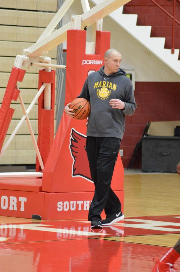 Head coach Jordan Dever leads a practice on Jan. 29. Dever previously played for Marian University.