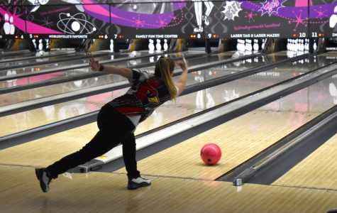 Senior Madison Woodmansee releases the bowling ball during one of her turns at regionals on Jan. 18. Woodmansee started her bowling career in middle school.